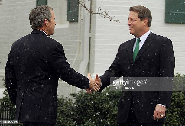 Presidentelect George W Bush is greeted 19 December 2000 by his presidential campaign opponent US Vice President Al Gore at Gore's Washington DC home...