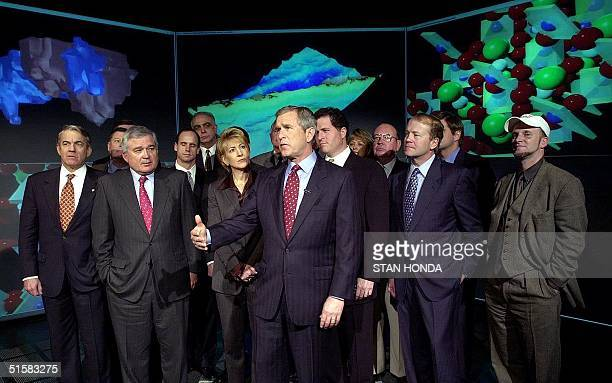 Presidentelect George W Bush with business leaders from technology companies meet 04 January in front of three dimentional simulations at the...
