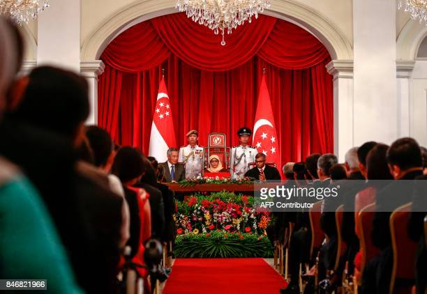 Presidentelect Halimah Yacob delivers a speech flanked by Singapore Prime Minister Lee Hsien Loong and Chief Justice Sundaresh Menon during the...