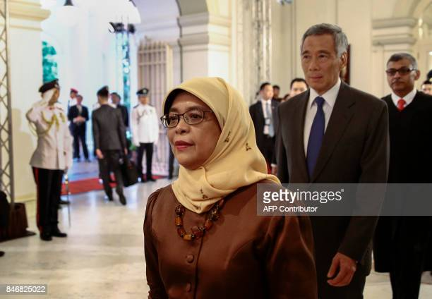 Presidentelect Halimah Yacob Singapore Prime Minister Lee Hsien Loong and Chief Justice Sundaresh Menon enter the state room before the presidential...