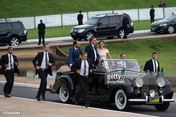 Presidentelect Jair Bolsonaro and his wife Michelle Bolsonaro arrive to the National Congress before Jair Bolsonaro's swearingin ceremony as the 38th...