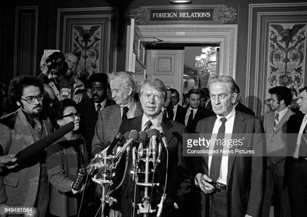 US PresidentElect Jimmy Carter talks to the press outside the Senate Foreign Relations Committee Room in the US Capitol Washington DC November 23 1976