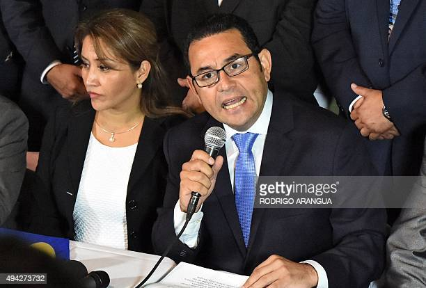 Presidentelect Jimmy Morales of the National Front Convergence delivers a speech next to his wife Hilda Marroquin after winning the runoff election...
