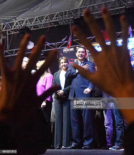 Presidentelect Jimmy Morales of the National Front Convergence waves a supporters after winning the runoff election in Guatemala City on October 26...