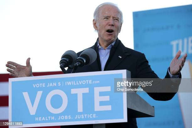 President-elect Joe Biden addresses a campaign rally with Democratic candidates for the U.S. Senate Jon Ossoff and Rev. Raphael Warnock the day...