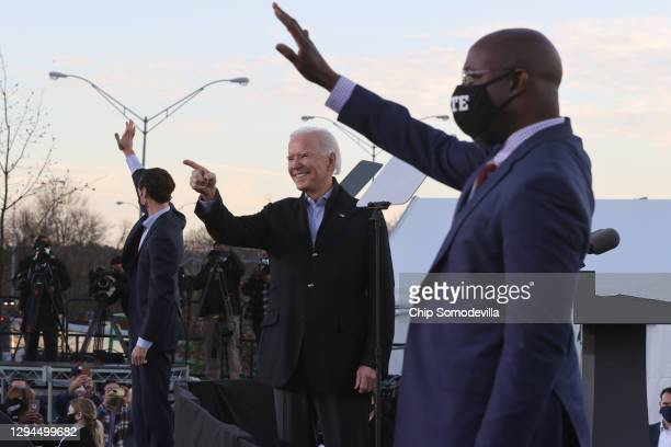 President-elect Joe Biden along with democratic candidates for the U.S. Senate Jon Ossoff and Rev. Raphael Warnock greet supporters during a campaign...