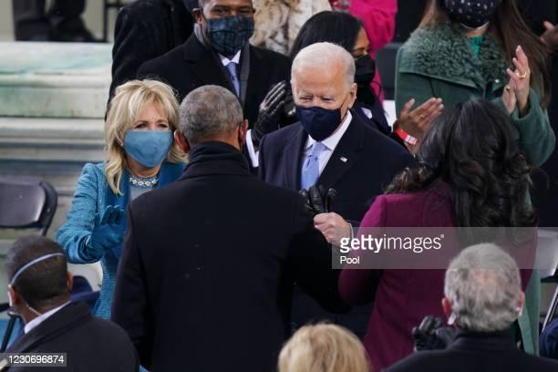 President-elect Joe Biden and Dr. Jill Biden speak with former President Barack Obama before Joe Biden was sworn in on the West Front of the U.S....