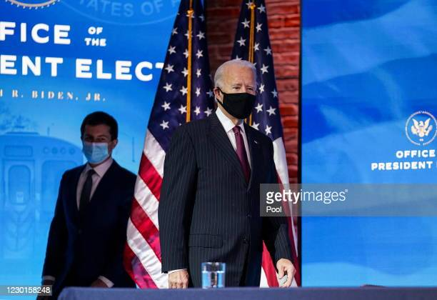 President-elect Joe Biden and former Democratic presidential candidate Pete Buttigieg arrive for a news conference at Biden's transition headquarters...