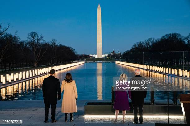 President-elect Joe Biden, and his wife Dr. Jill Biden stand along Vice Presidential-elect Kamala Harris and her husband Doug Emhoff take a moment of...