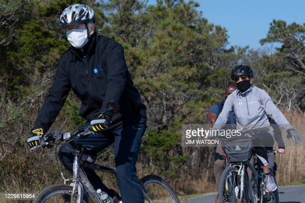 President-elect Joe Biden and his wife Jill Biden ride their bikes at Cape Henlopen State Park near Rehoboth Beach, Delaware, on November 14, 2020.