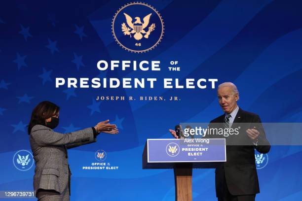 President-elect Joe Biden and U.S. Vice President-elect Kamala Harris gesture during an announcement January 16, 2021 at the Queen theater in...