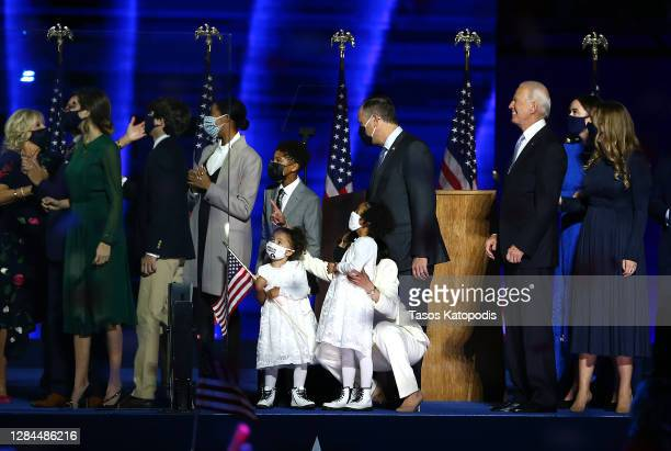 President-elect Joe Biden and Vice President-elect Kamala Harris and their families watch fireworks from stage after Biden's address to the nation...