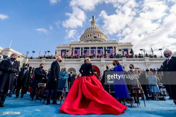 President-elect Joe Biden and Vice President-elect Kamala Harris speak to Lady Gaga as she departs after singing the national anthem as Vice...