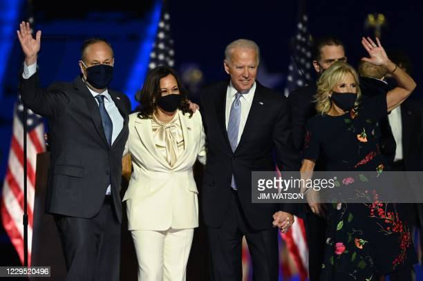 President-elect Joe Biden and Vice President-elect Kamala Harris stand with spouses Jill Biden and Doug Emhoff after delivering remarks in...