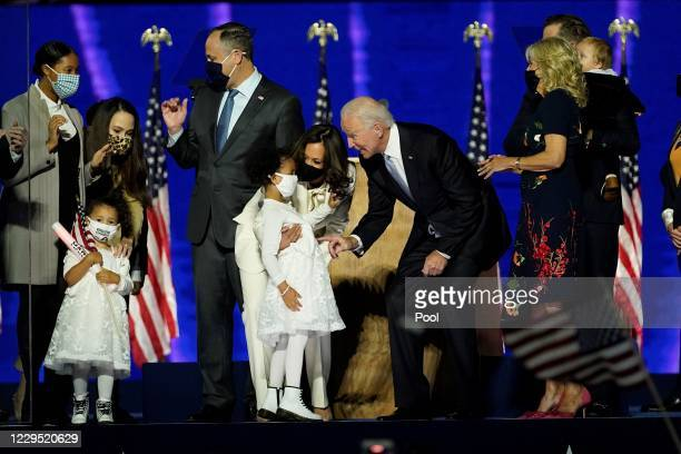 President-elect Joe Biden and Vice President-elect Kamala Harris interact with their family members after addressing the nation from the Chase Center...