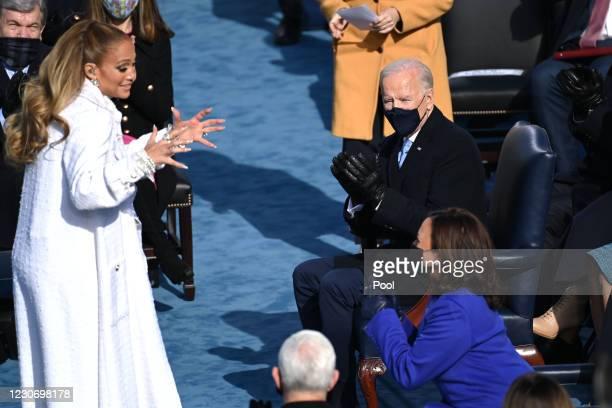 President-elect Joe Biden applauds US Vice President-elect Kamala Harris talks to singer Jennifer Lopez during the 59th Presidential Inauguration at...