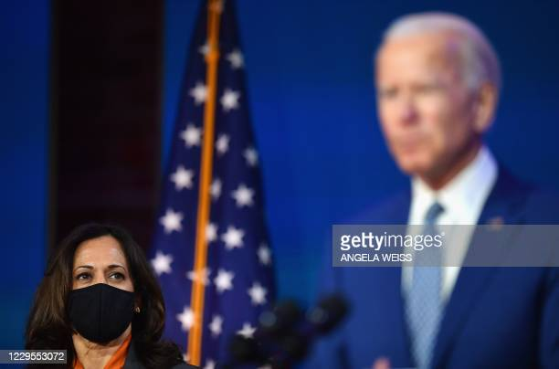 President-elect Joe Biden delivers remarks as US Vice President-elect Kamala Harris listens at The Queen in Wilmington, Delaware, on November 9,...