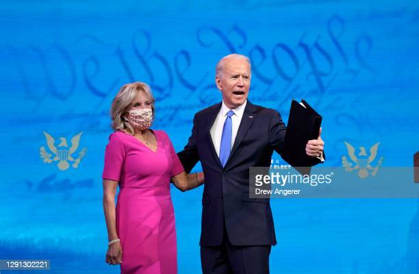 President-elect Joe Biden embraces his wife Dr. Jill Biden after speaking about the Electoral College vote certification process at The Queen theater...