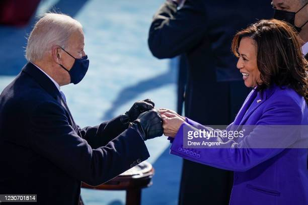 President-elect Joe Biden fist bumps newly sworn-in Vice President Kamala Harris after she took the oath of office on the West Front of the U.S....