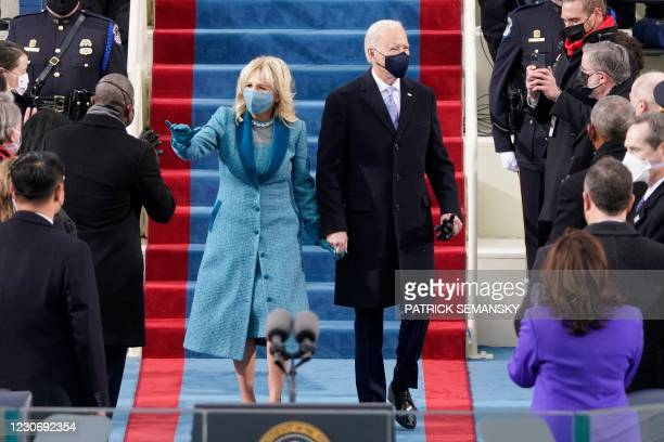 President-elect Joe Biden flanked by wife Dr. Jill Biden arriving for his inauguration as the 46th US President on January 20 at the US Capitol in...