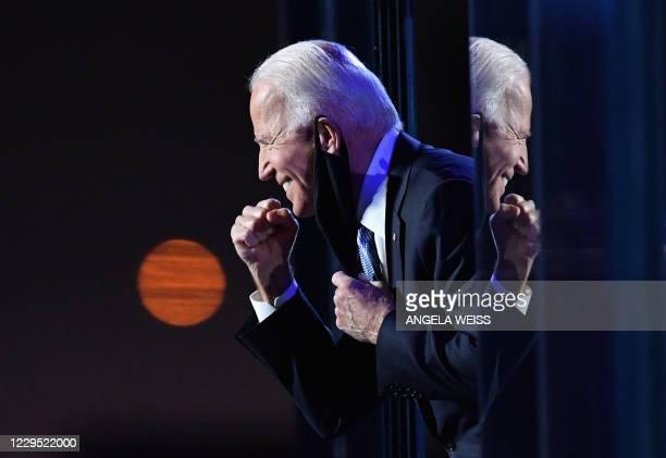 President-elect Joe Biden gestures to the crowd after he delivered remarks in Wilmington, Delaware, on November 7, 2020. - Democrat Joe Biden was...