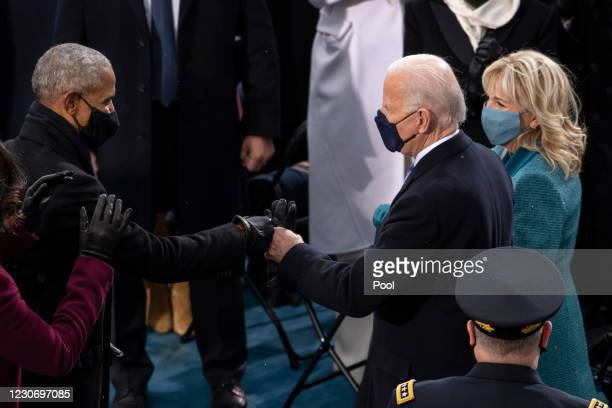 President-elect Joe Biden greets former President Barack Obama for the inauguration of Biden on the West Front of the U.S. Capitol on January 20,...