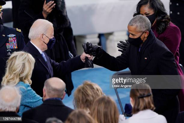 President-elect Joe Biden greets former U.S. President Barack Obama upon arriving to Biden's inauguration on the West Front of the U.S. Capitol on...