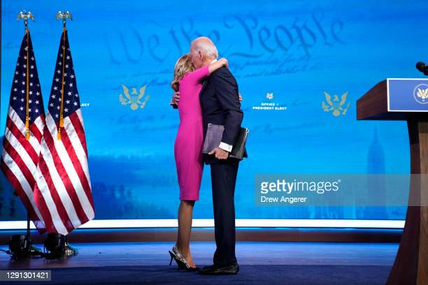 President-elect Joe Biden hugs his wife Dr. Jill Biden after speaking about the Electoral College vote certification process at The Queen theater on...