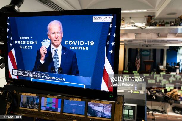 President-elect Joe Biden is shown speaking on a monitor about coronavirus disease in the briefing room of the White House on November 9, 2020 in...