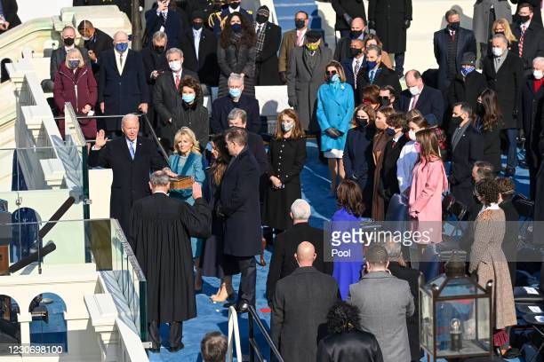 President-elect Joe Biden is sworn in as his wife Jill Biden holds the Bible during the 59th Presidential Inauguration at the U.S. Capitol on January...