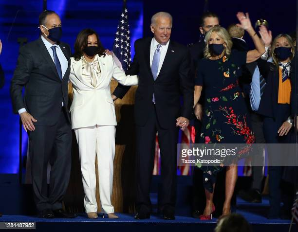 President-elect Joe Biden, Jill Biden, Vice President-elect Kamala Harris and husband Doug Emhoff wave to crowd on stage after Biden's address to the...