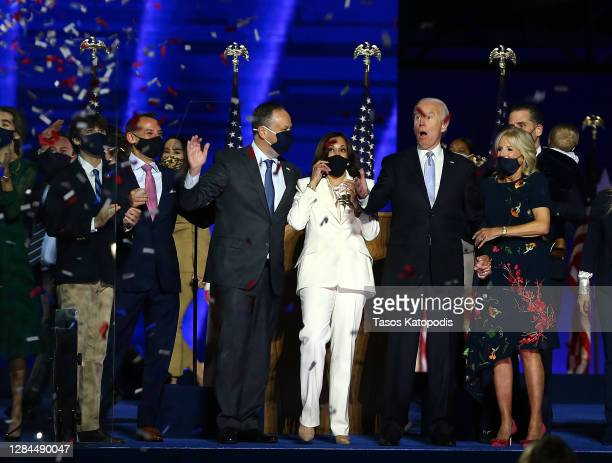 President-elect Joe Biden, Jill Biden, Vice President-elect Kamala Harris and husband Doug Emhoff wave to crowd on stage after Biden's address to the...