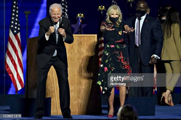 President-elect Joe Biden, left, and wife Jill Biden gesture to the audience during an election event in Wilmington, Delaware, U.S., on Saturday,...