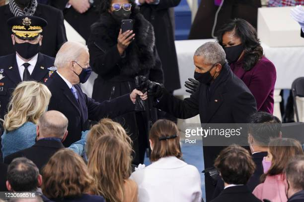 President-elect Joe Biden, left, greets former U.S. President Barack Obama, right, with a fist bump during the inauguration on the West Front of the...
