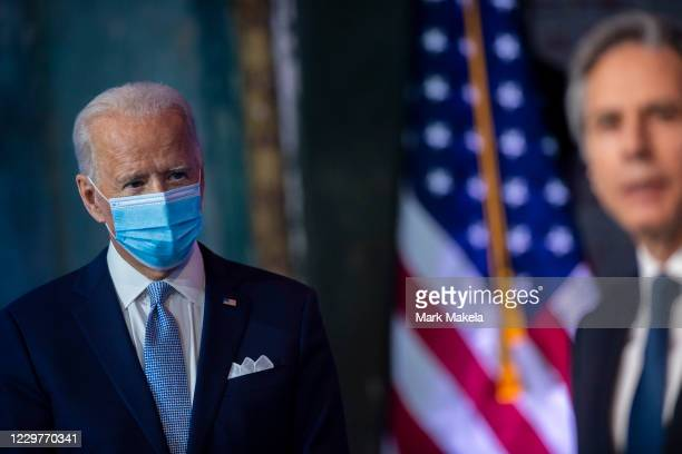 President-elect Joe Biden listens as Secretary of State nominee Antony Blinken speaks at an event to introduce key foreign policy and national...