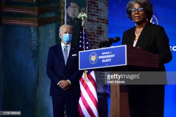 Presidentelect Joe Biden listens as US Ambassador to the United Nations nominee Linda ThomasGreenfield speaks after being introduced at an event...