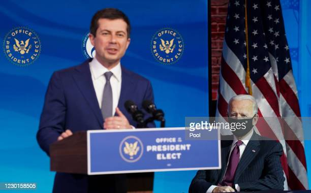 President-elect Joe Biden looks on as former Democratic presidential candidate Pete Buttigieg speaks after he was nominated to be Secretary of...