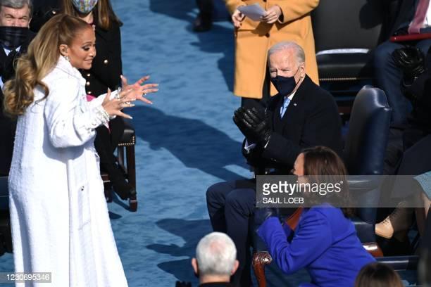 President-elect Joe Biden looks on as US Vice President-elect Kamala Harris talks to US singer Jennifer Lopez during the 59th Inauguration ceremony...