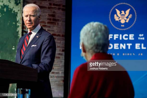 President-elect Joe Biden looks towards appointee for National Climate Advisor, Gina McCarthy, as he announces members of his climate and energy...