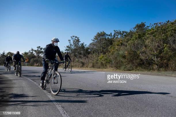 President-elect Joe Biden rides his bike at Cape Henlopen State Park near Rehoboth Beach, Delaware, on November 14, 2020.