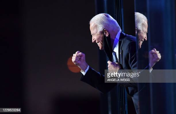 President-elect Joe Biden smiles to supporters at after he delivered remarks in Wilmington, Delaware, on November 7, 2020. - Democrat Joe Biden was...