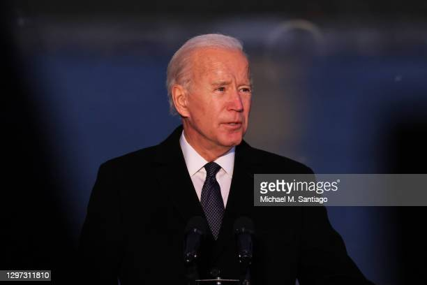 President-elect Joe Biden speaks at a memorial for victims of the coronavirus pandemic at the Lincoln Memorial on the eve of the presidential...