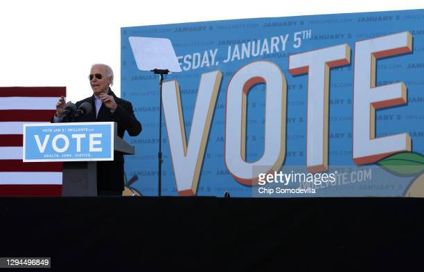 President-elect Joe Biden speaks during a campaign rally with Democratic candidates for the U.S. Senate Jon Ossoff and Rev. Raphael Warnock the day...