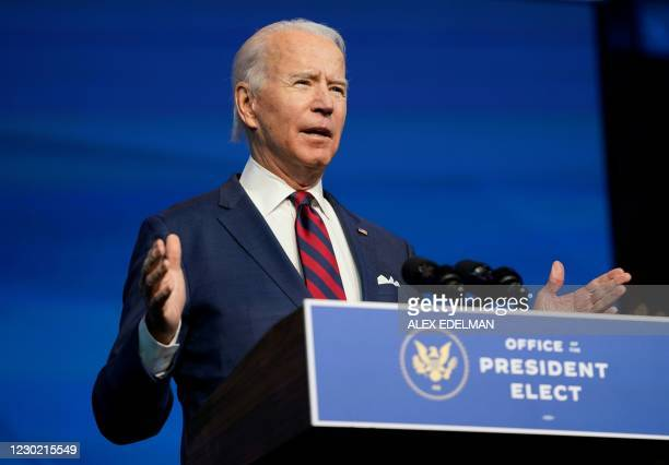 President-elect Joe Biden speaks during an event to introduce key Cabinet nominees and members of his climate team at The Queen Theater in...