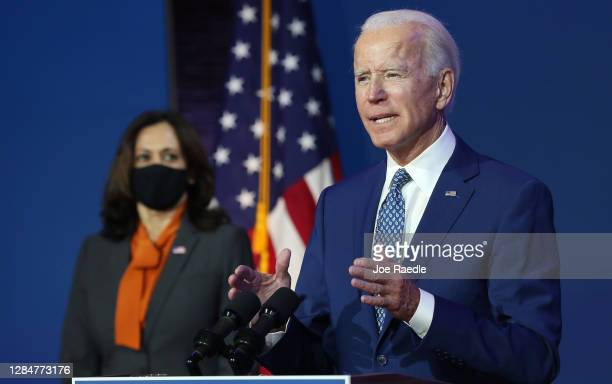 President-elect Joe Biden speaks to the media while flanked by Vice President-elect Kamala Harris, at the Queen Theater after receiving a briefing...