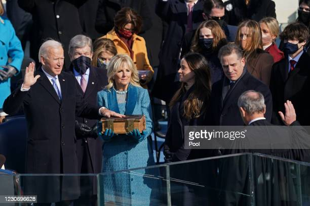 President-elect Joe Biden takes the oath of office at the West Front of the U.S. Capitol during the inauguration of Biden on the West Front of the...