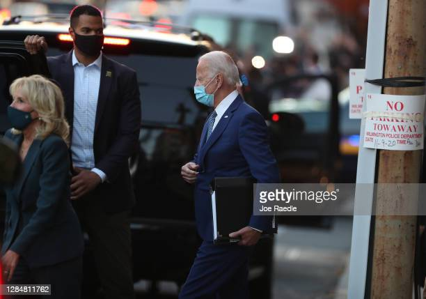 President-elect Joe Biden walks to his vehicle as he leaves the Queen theater after receiving a briefing from the transition COVID-19 advisory board...