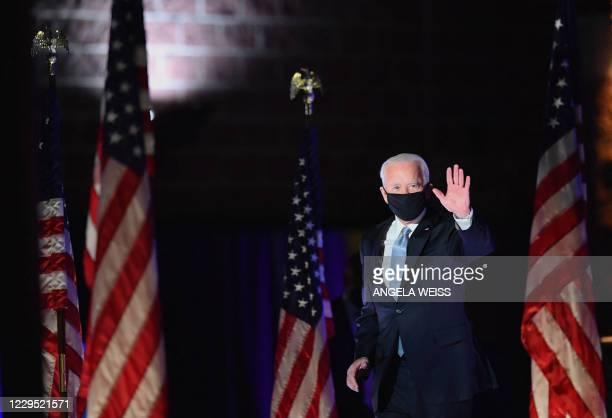 President-elect Joe Biden waves as he arrives to deliver remarks in Wilmington, Delaware, on November 7, 2020. - Democrat Joe Biden was declared...