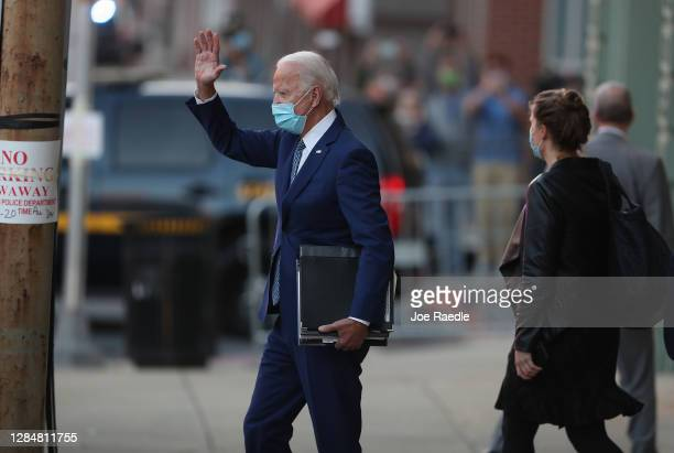 President-elect Joe Biden waves to supporters as he leaves the Queen theater after receiving a briefing from the transition COVID-19 advisory board...