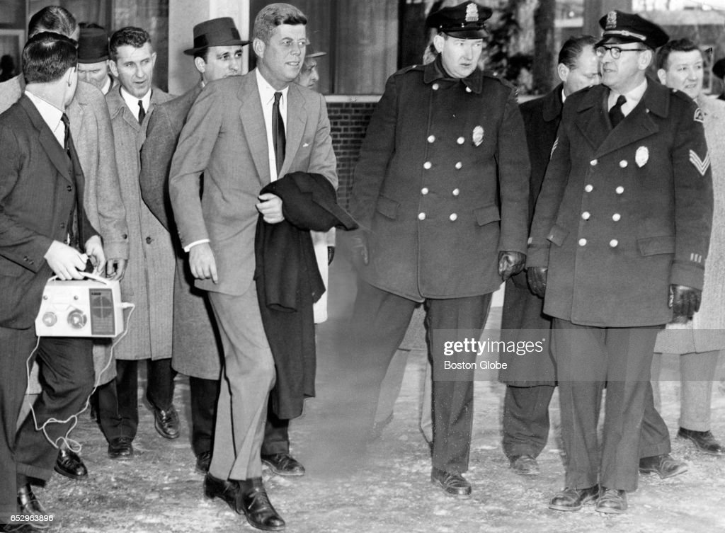President-elect John F. Kennedy leaves the Loeb Drama Center on Brattle Street in Cambridge, MA for the home of Harvard professor Arthur S. Schlesinger Jr. during his visit to the university as a member of the board of overseers on Jan. 9, 1961.
